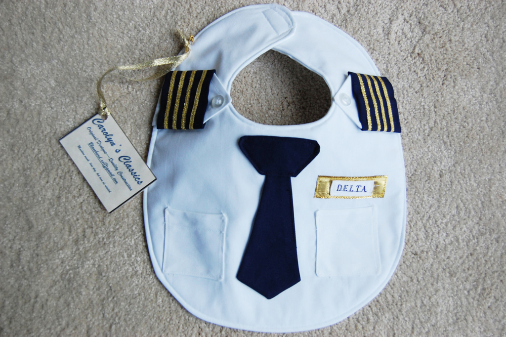 Truly adorable and one of a kind baby bib for your little captain! Each bib can be customized to feature the airline of choice and is handmade and authentic. Every baby needs the proper uniform when the airplane comes into land.